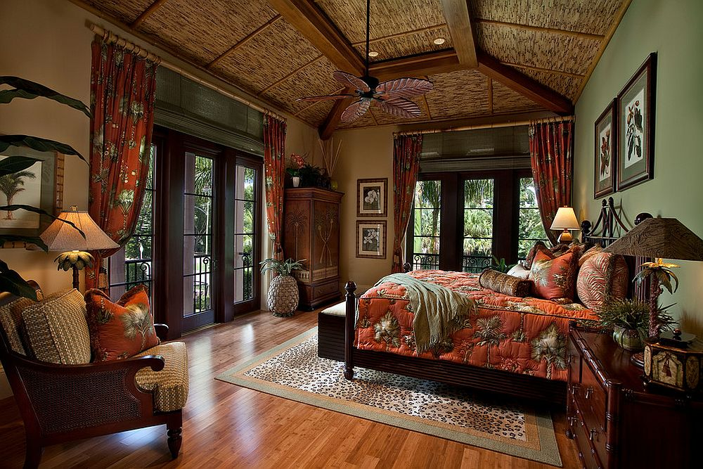 Exquisite tropical style bedroom with pops of orange and full of natural charm