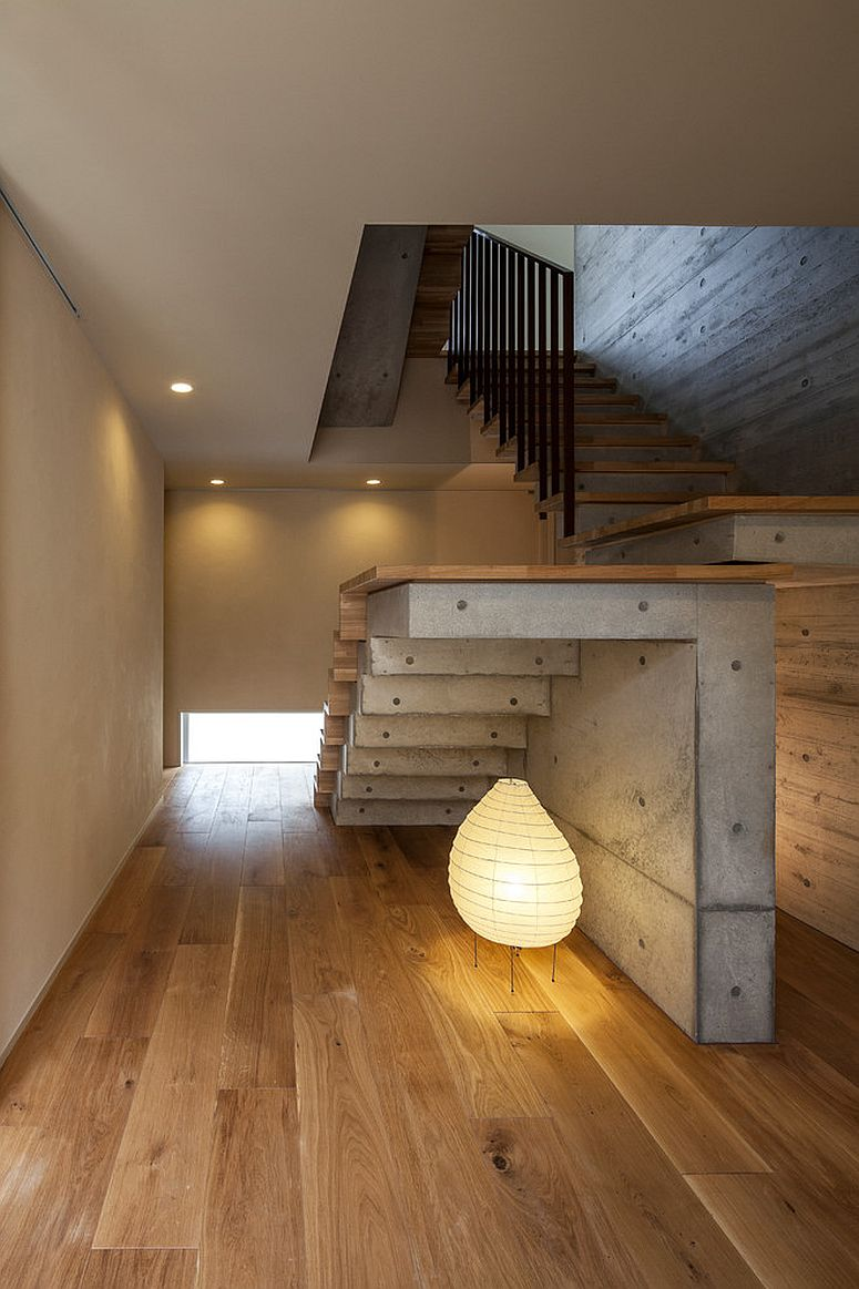Fabulous contemporary lighting under the stairway makes a big visual impact