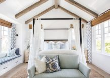 Four-poster-bed-along-with-the-slanting-ceiling-beams-bring-holiday-vibe-to-this-bedroom-217x155