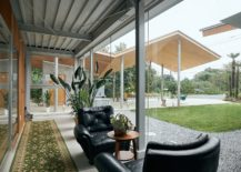 Glass-walls-ensure-that-the-outdoors-are-always-a-part-of-the-interior-217x155