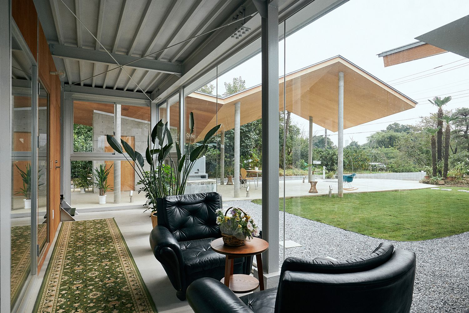 Glass walls ensure that the outdoors are always a part of the interior