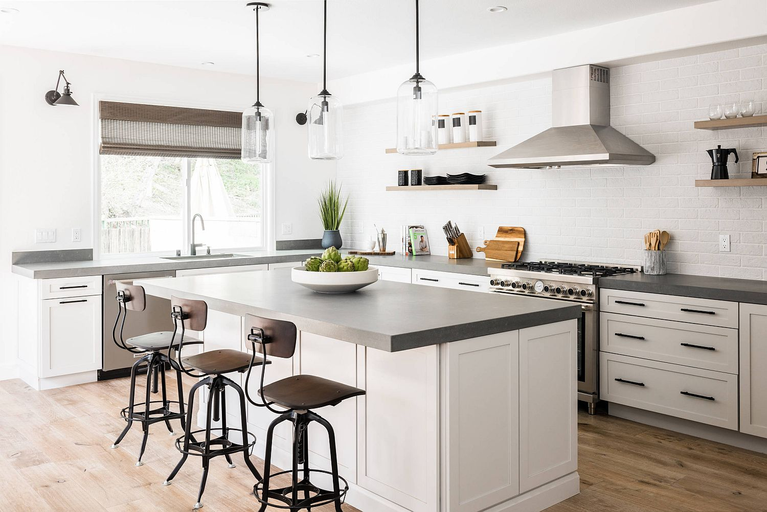 Gorgeous countertops anchor the white kitchen and add visual contrast