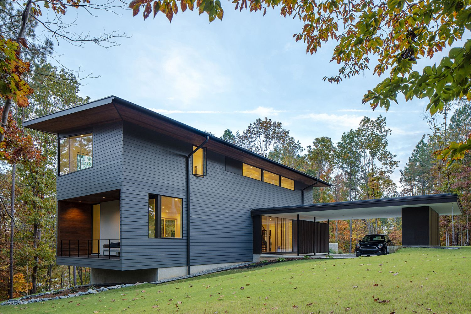Gorgeous gray exterior and straight lines accentuate the contemporary appeal of the house