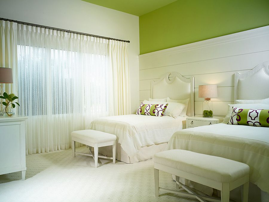 Green painted ceiling and white backdrop in the bedroom creates a bright and relaxing setting