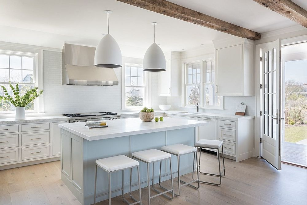 Hint of pastel blue combined with ample white in the light-filled kitchen