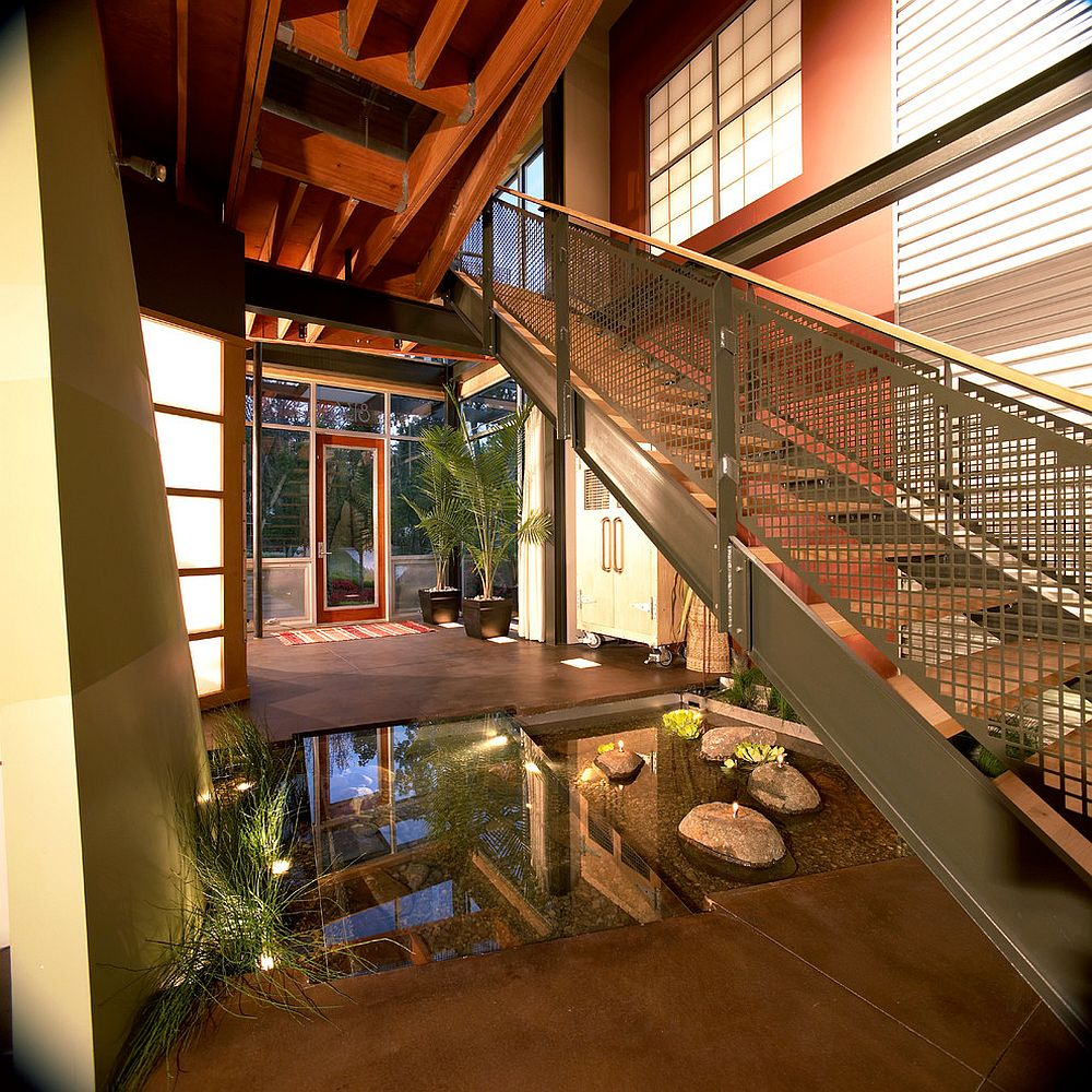 Indoor pond under the staircase is a showstopper