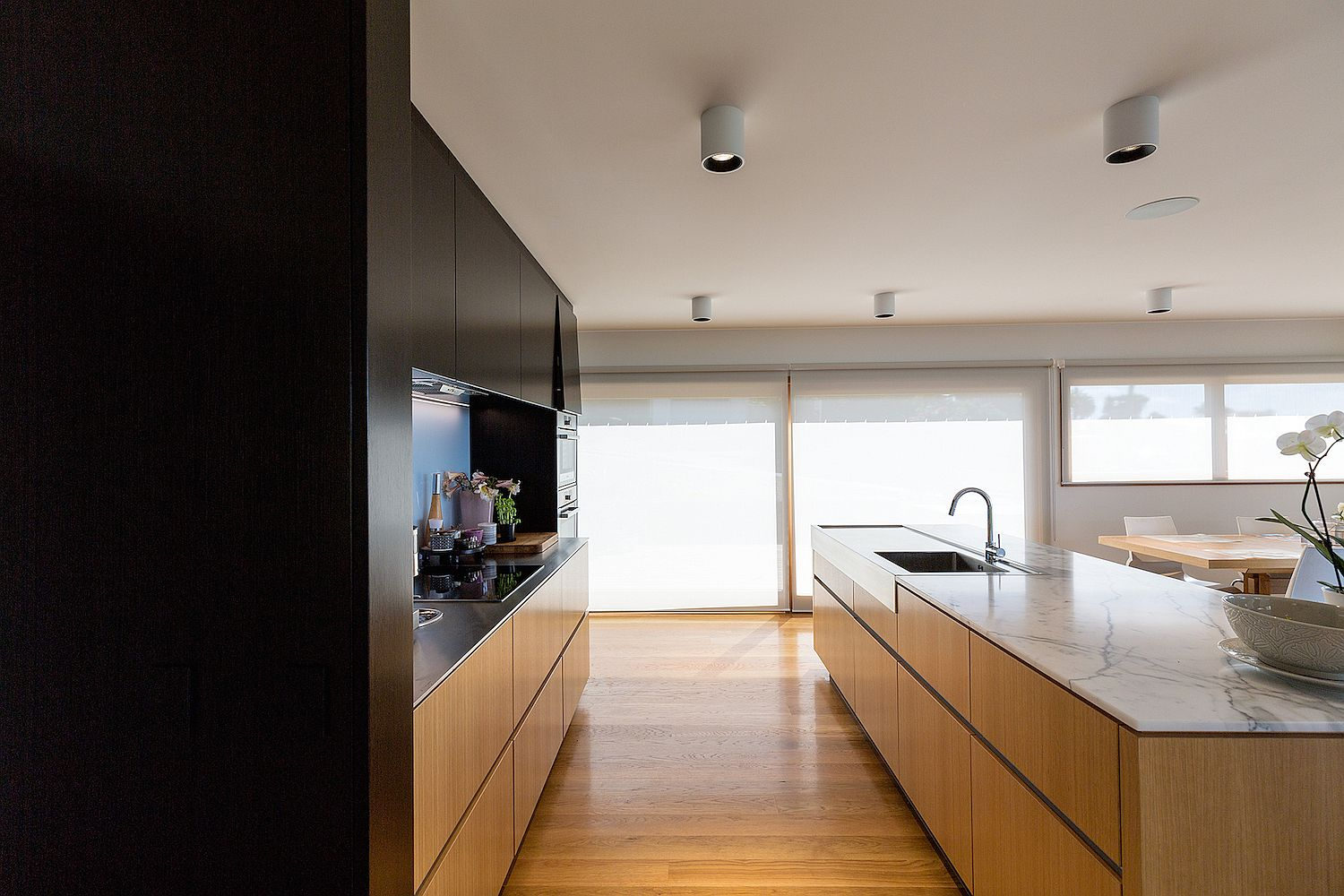 Kitchen and dining area along with the living space in wood with unabated views
