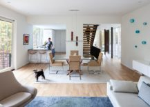Kitchen-dining-area-and-living-space-in-white-and-wood-with-pops-of-blue-217x155