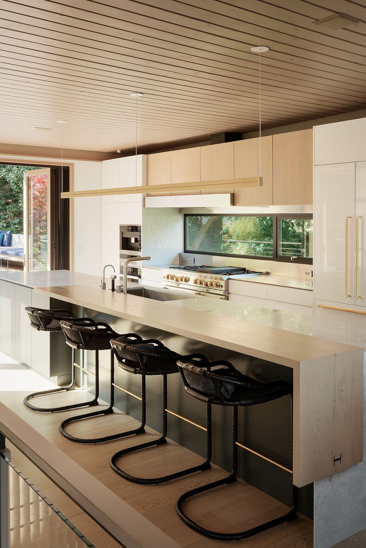 Kitchen of the Twin Peaks Residence with wood and white palette
