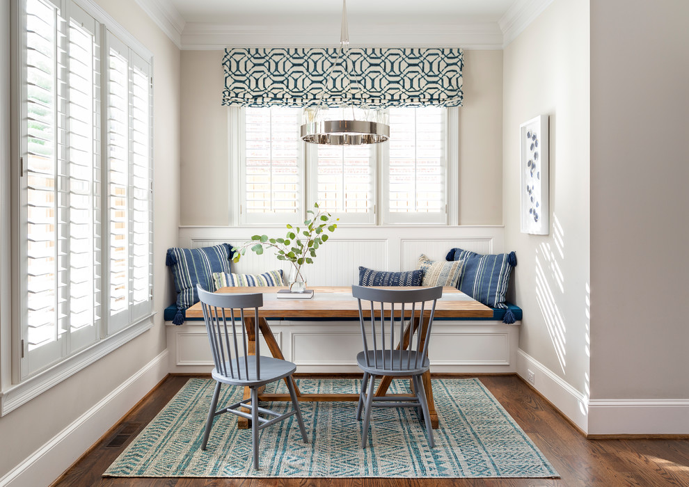 Light-filled beach style dining room in white with pops of blue