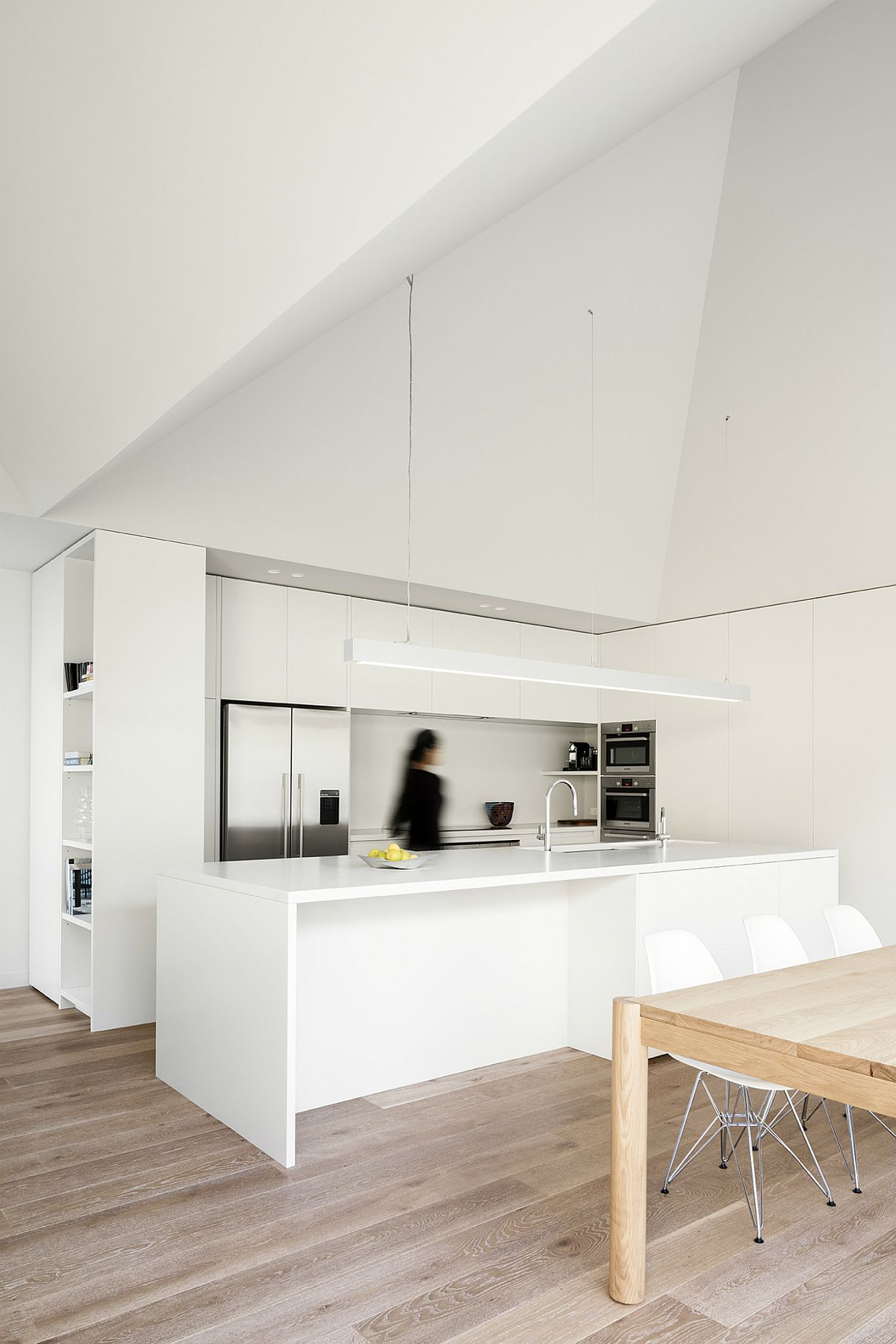 Minimal all-white kitchen with space-savvy shelving