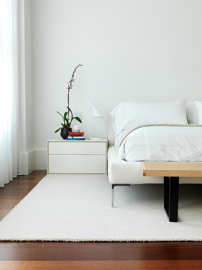 Minimal modern bedroom in white with wooden floor
