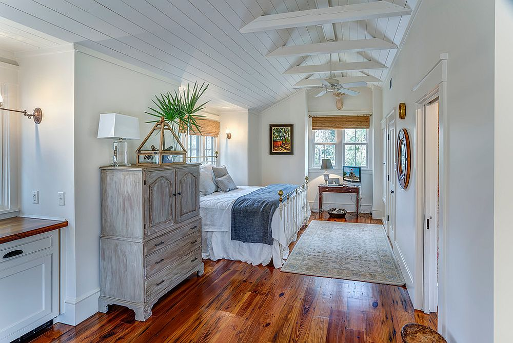 Modern beach style bedroom feels like an extension of areas around it