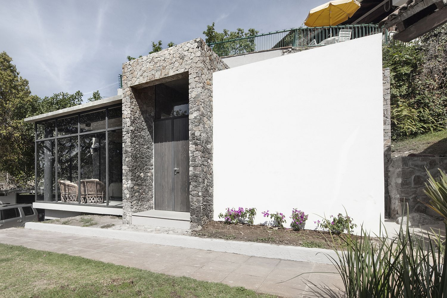 Modern finishes are coupled with natural stone to create a unique home in Mexico