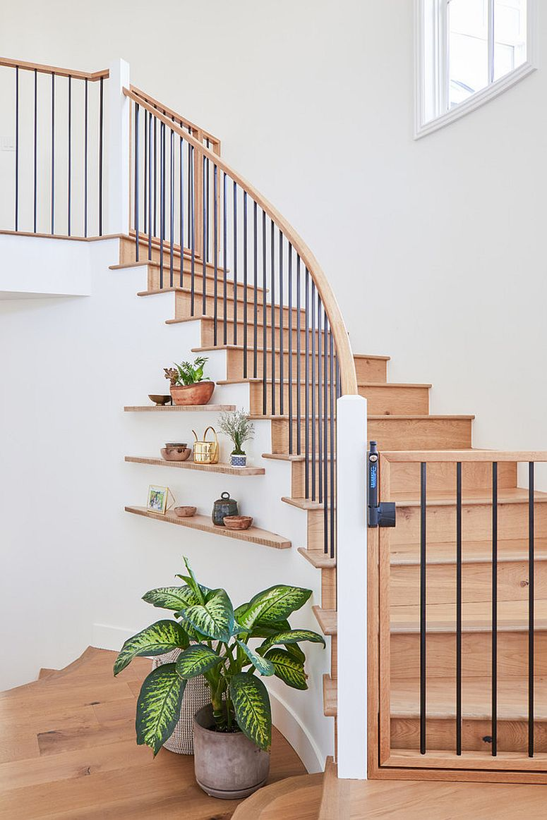 Modern floating shelves under the staircase feels simple and elegant