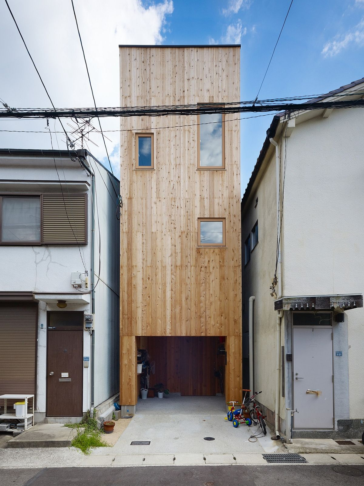 Narrow, multi-level home in Japan with an exterior draped in wood