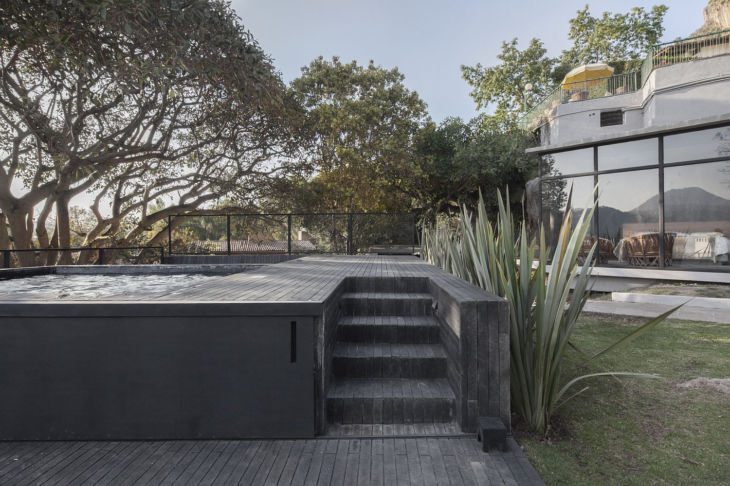 Outdoor sitting area, Jacuzzi and dining space of the Mexican house