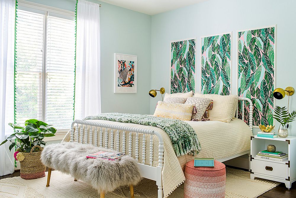 Pastel colors coupled with greenery in the spacious, light-filled tropical bedroom