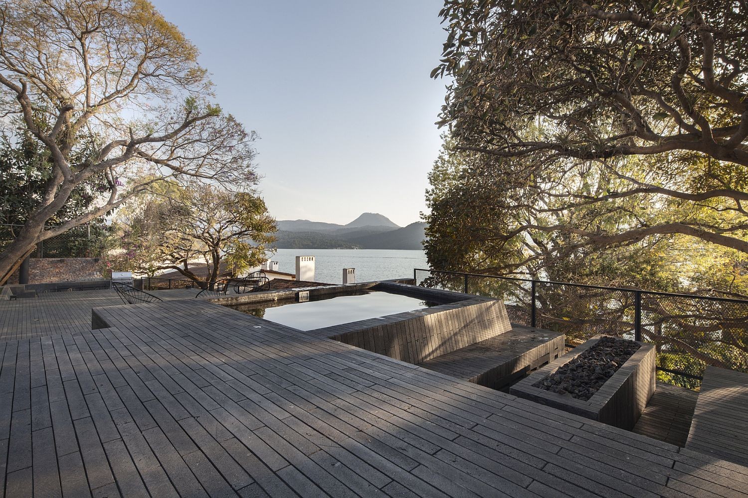 Perfect outdoor recreational area with Jacuzzi that offers lake views