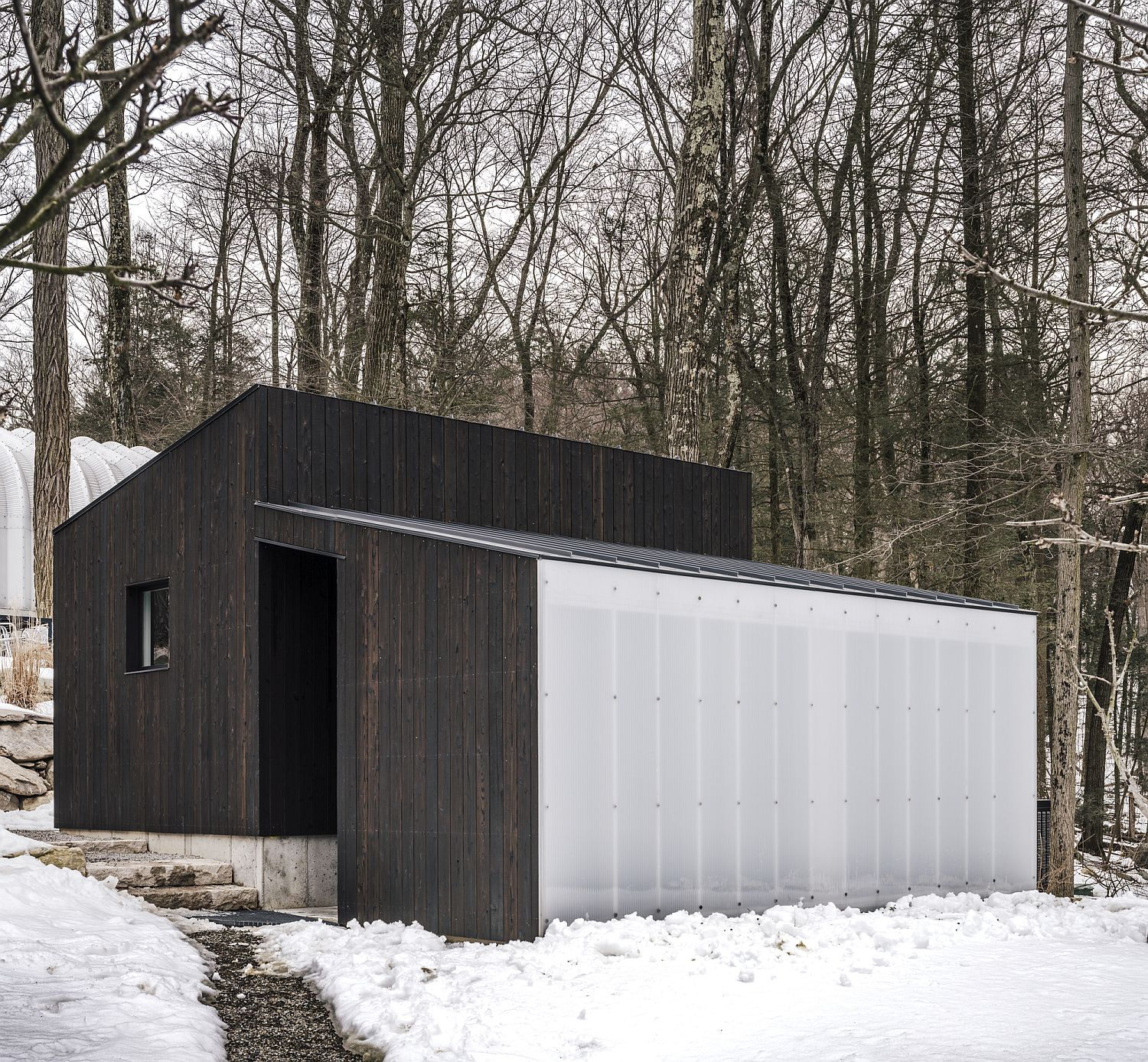 Polycarbonate-wall-brings-natural-light-into-the-structure-with-ease