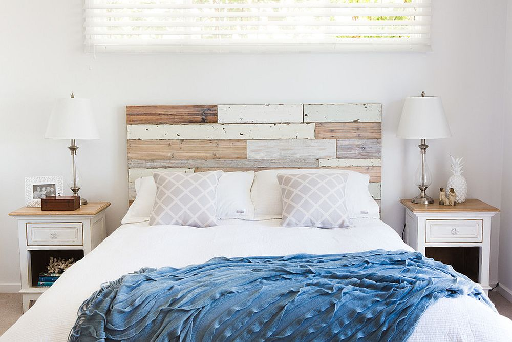 Reused wood pieces for the headboard in the beach style bedroom