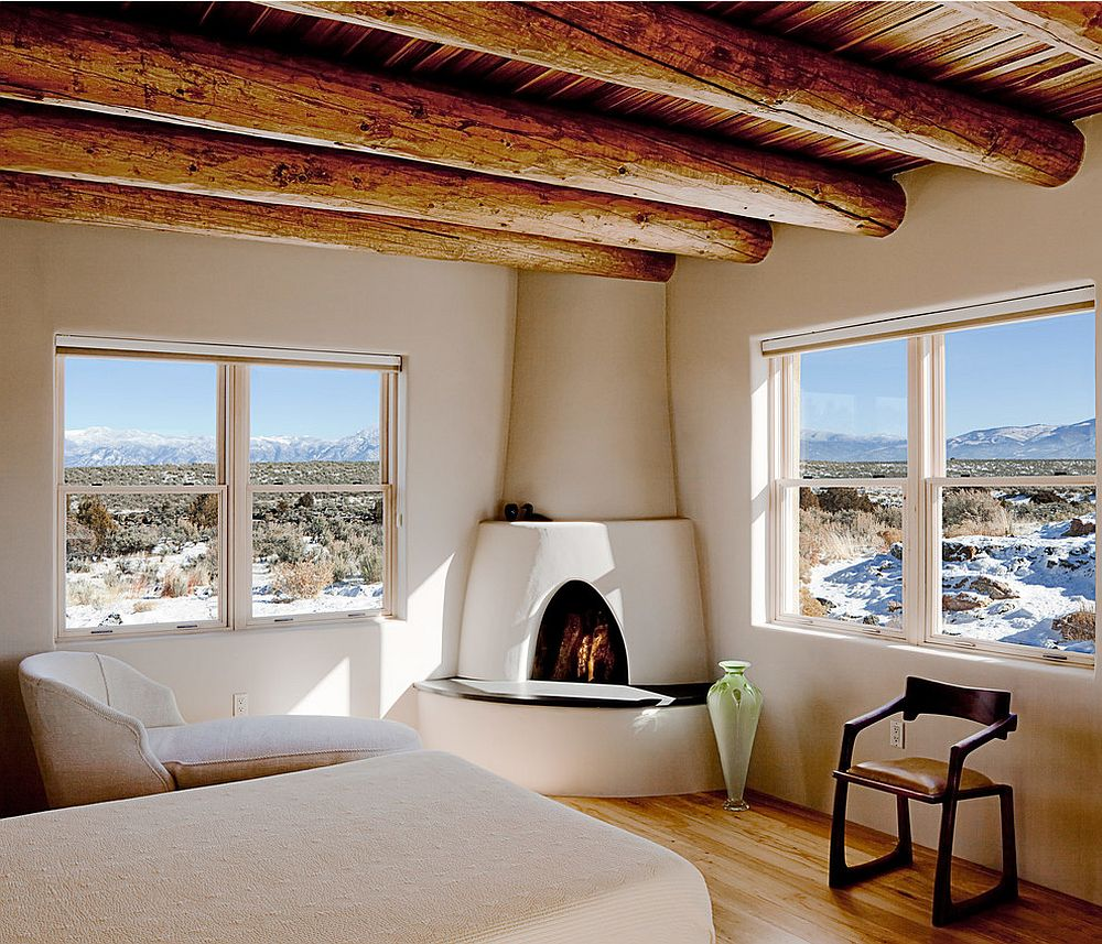 Round wooden ceiling beams for the lovely Southwestern style bedroom