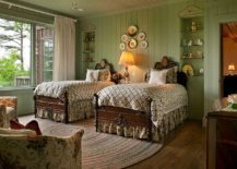 Rustic-bedroom-in-green-with-flowery-pattern-brought-in-by-the-armchairs-217x155
