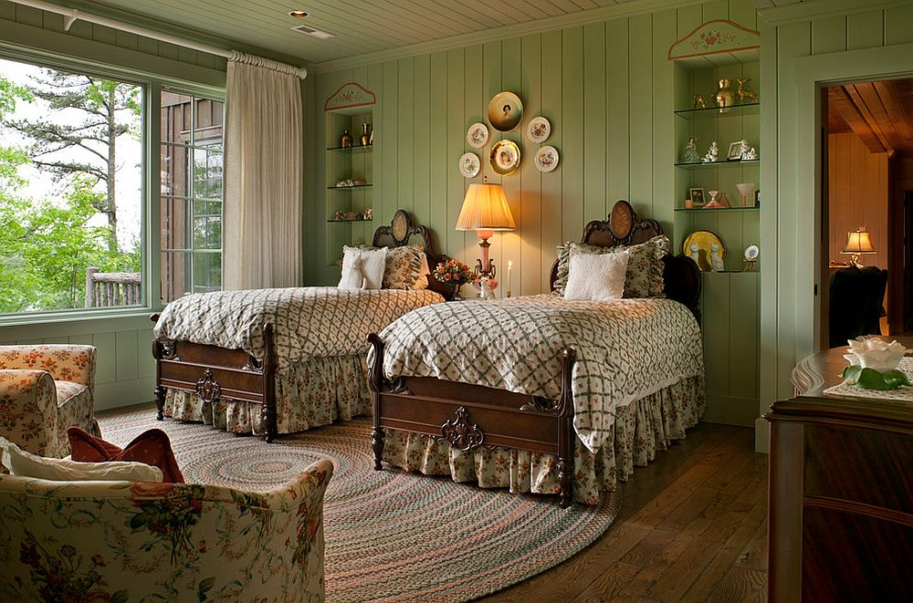 Rustic bedroom in green with flowery pattern brought in by the armchairs