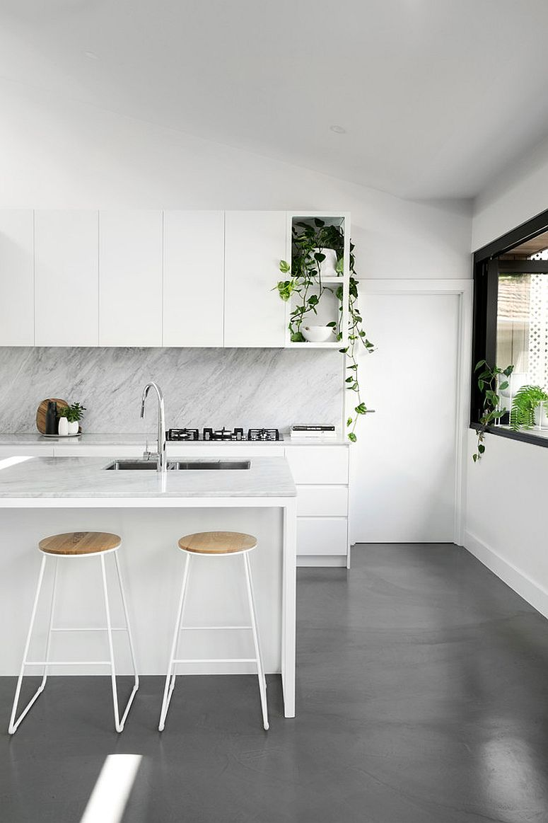 Sleek cabinets and closed storage units give this kitchen a minimal appeal
