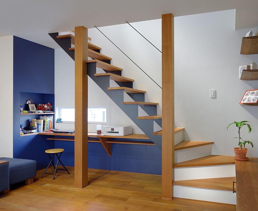 Slim and contemporary workspace underneath the staircase
