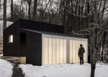 Small-Wooden-Pavilion-with-a-dark-wooden-exterior-and-polycarbonate-wall-217x155