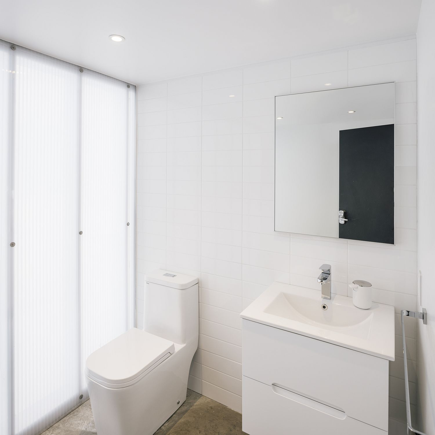 Small bathroom in white with ample natural lighting
