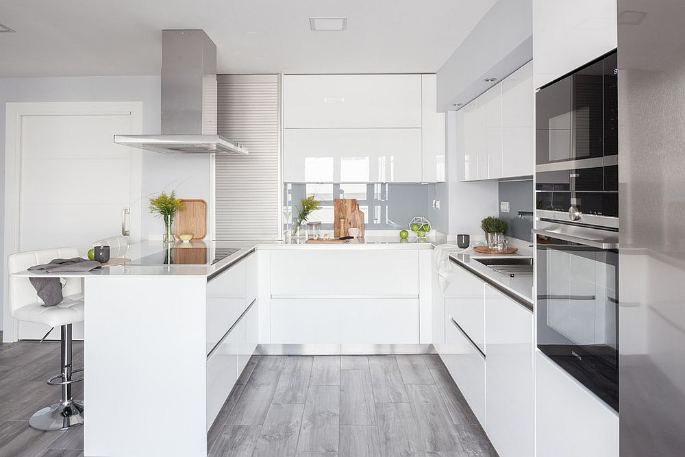 Smart and stylish kitchen in white saves ample space with its smart design