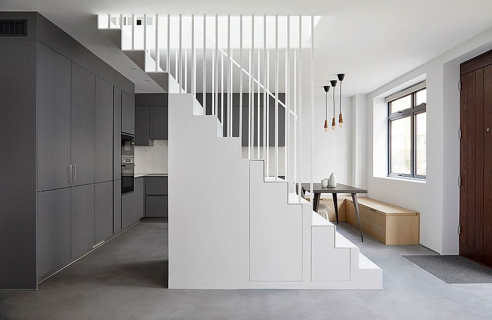 Smart stairway easily doubles as a storage space in the contemporary setting