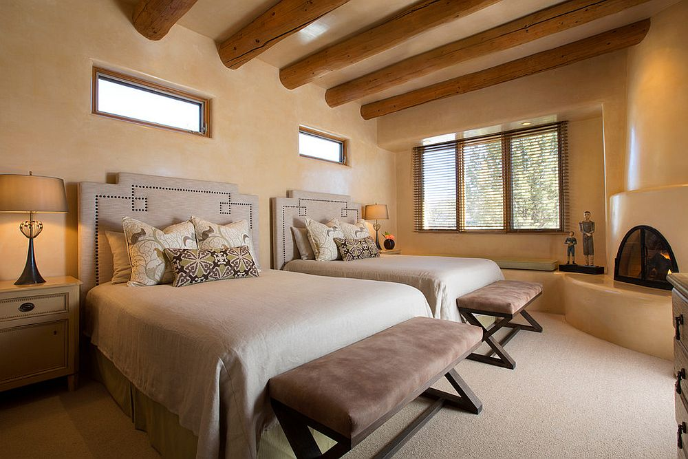 Smart textured walls and corner fireplace for the bedroom with ceiling beams