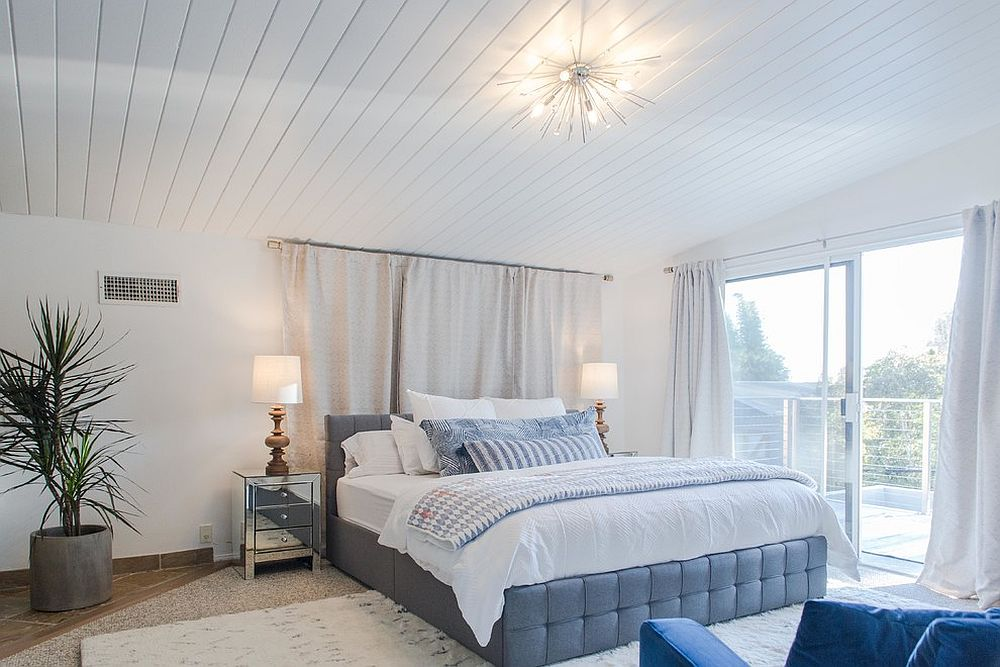 Spacious bedroom accentuates the beach style of the room with ease
