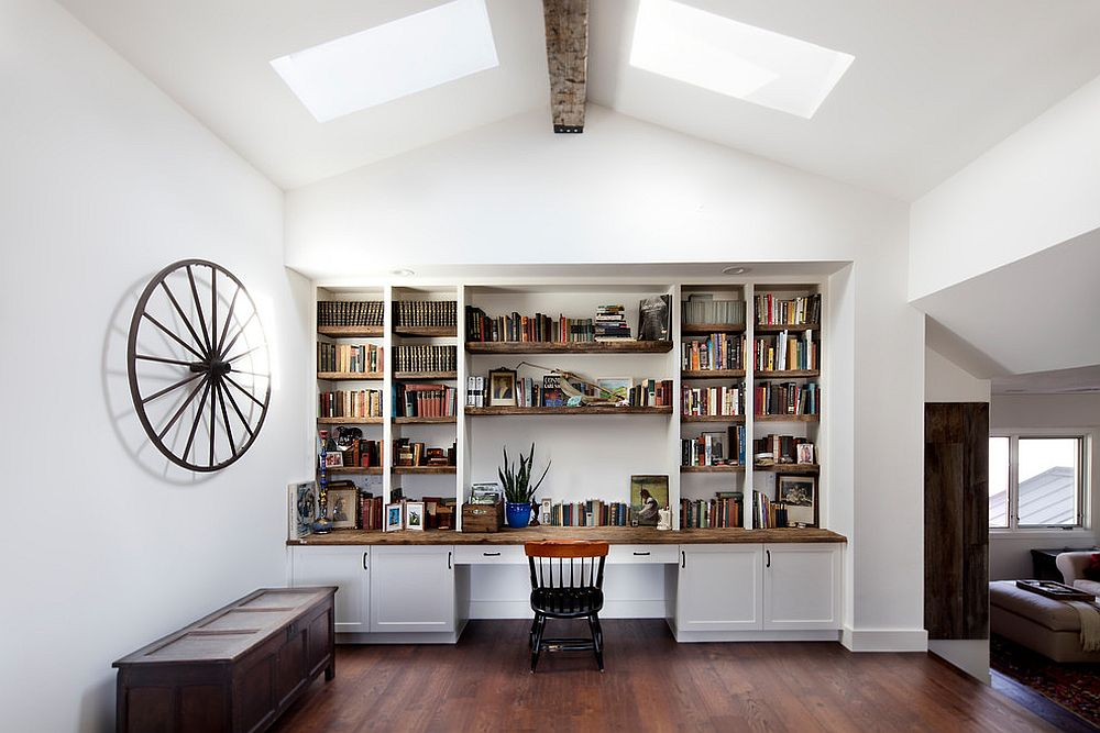 Spacious home office in white with a ceiling beam in wood and twin skylights
