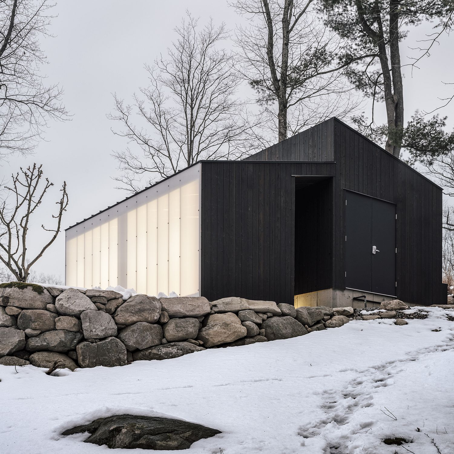 Stone-wood-and-polycarbonate-come-together-beautifully-at-this-small-pavilion