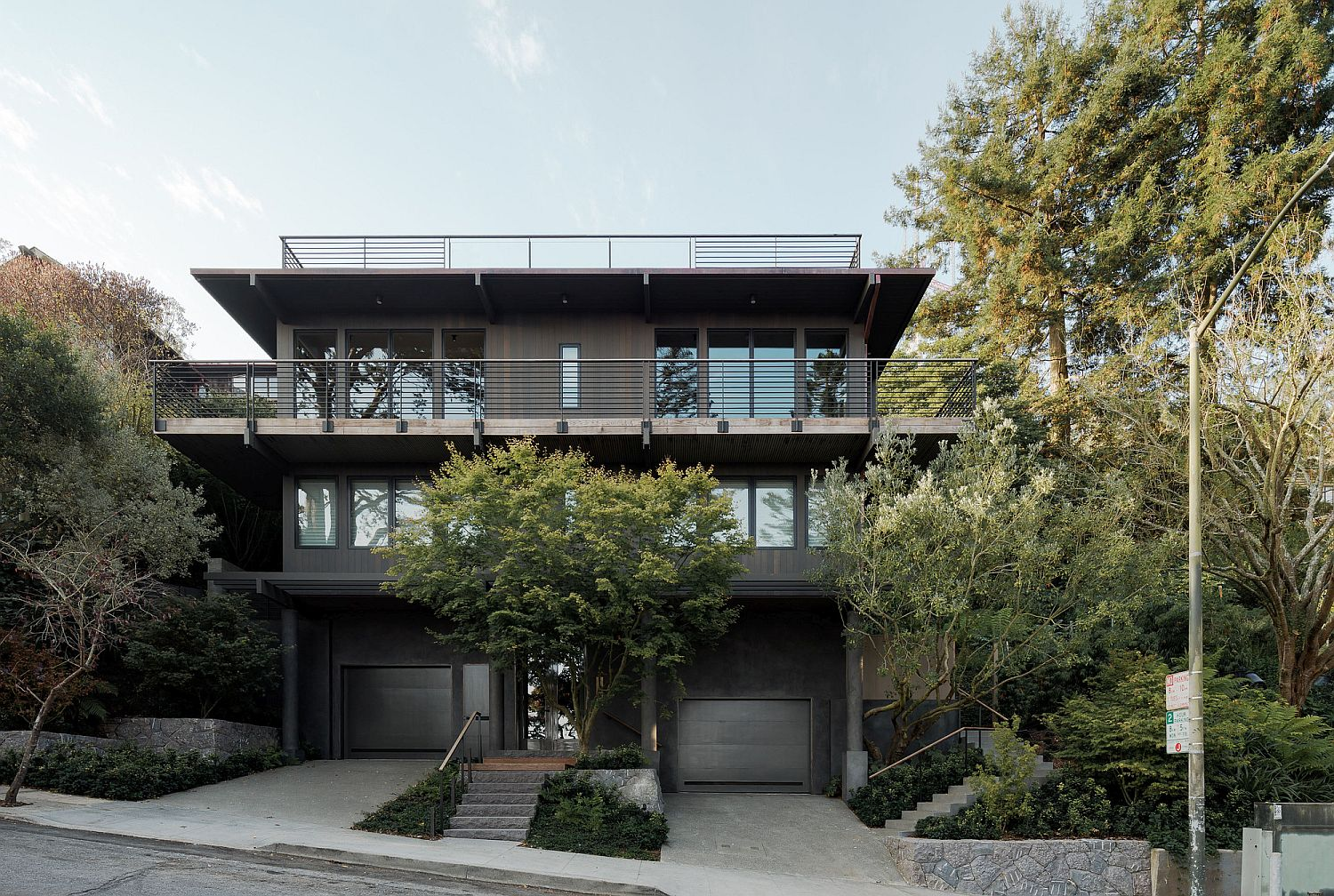 Street facade of the multi-level contemporary house with a view of the Golden Gate bridge