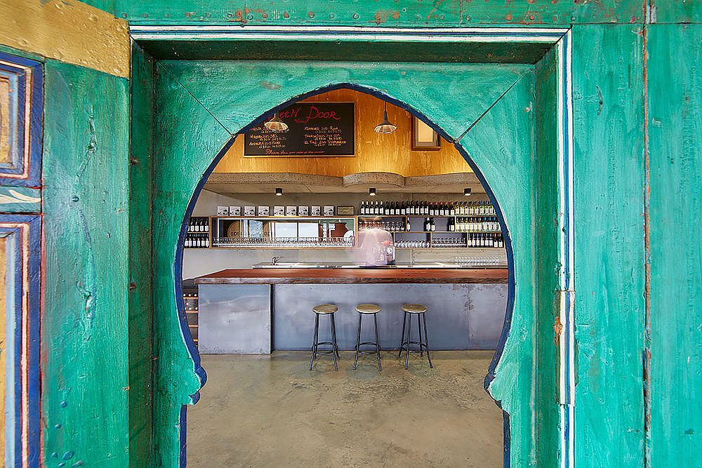 Striking green doors with Moroccan flavor welcome you to this winery in Ferguson Valley, Western Australia