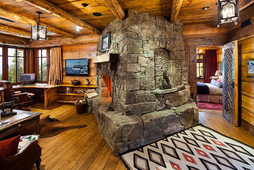 Stunning stone fireplace steals the show in this traditional home office