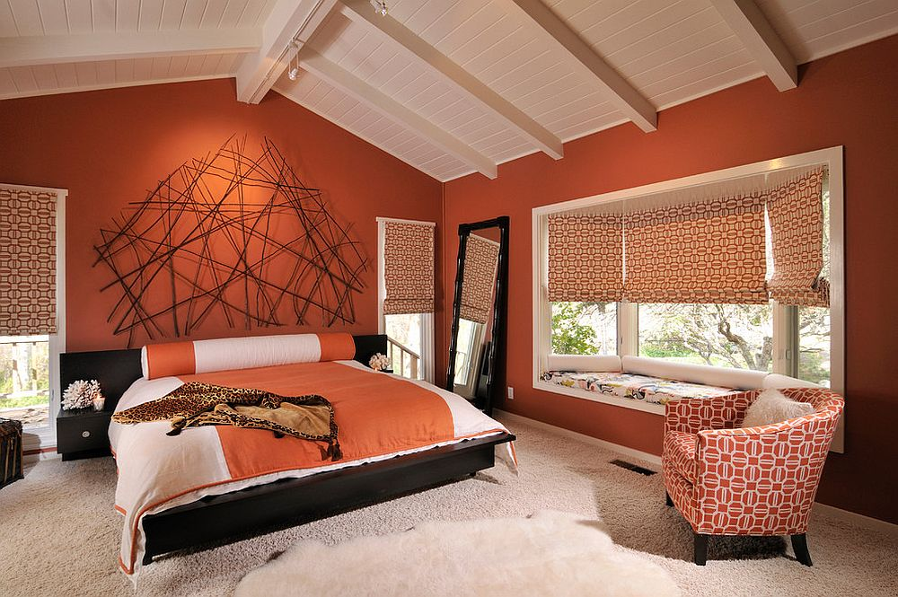 Stunning use of orange in the spacious modern bedroom with ceiling beams