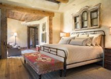 Textured-walls-and-wooden-ceiling-beams-create-a-cozy-gorgeous-bedroom-217x155