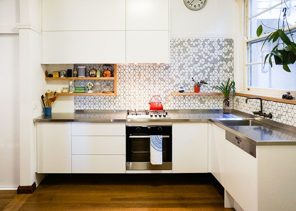 Tiles add pattern to the small white kitchen