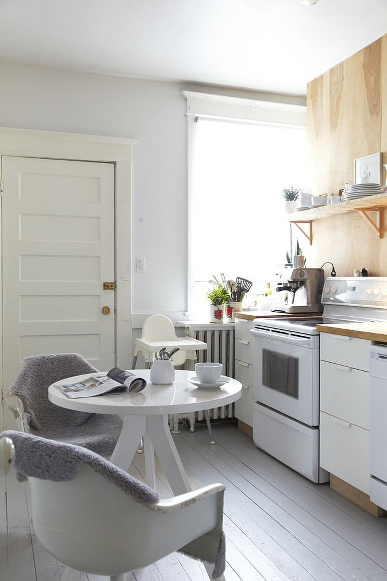 Tiny Scandinavian style kitchen in white in the corner