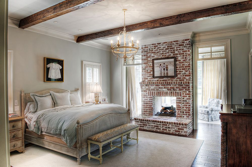 Traditional-bedroom-with-brick-wall-section-and-wooden-ceiling-beams