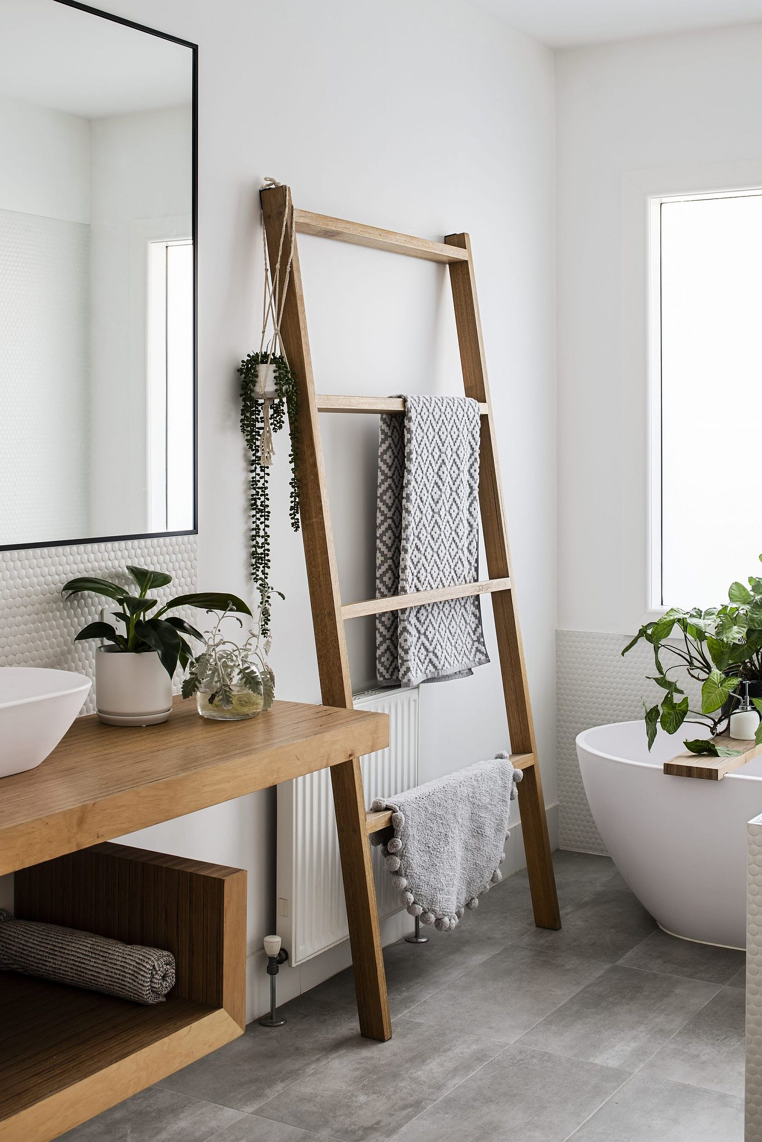 Two new contemporary bathrooms added to the house with white and gray taking over