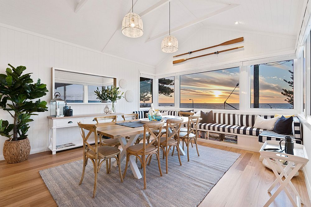 View of the the ocean and the sunset makes this beach style dining room even more special