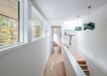 White-backdrop-and-wooden-floors-give-the-interior-a-spacious-light-filled-look-217x155