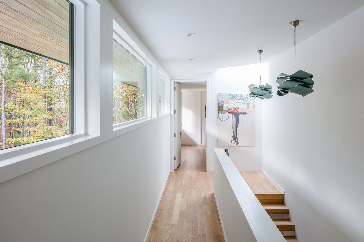 White backdrop and wooden floors give the interior a spacious, light-filled look